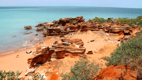 Orange cliffs and blue waters of Roebuck Bay, Western Australia