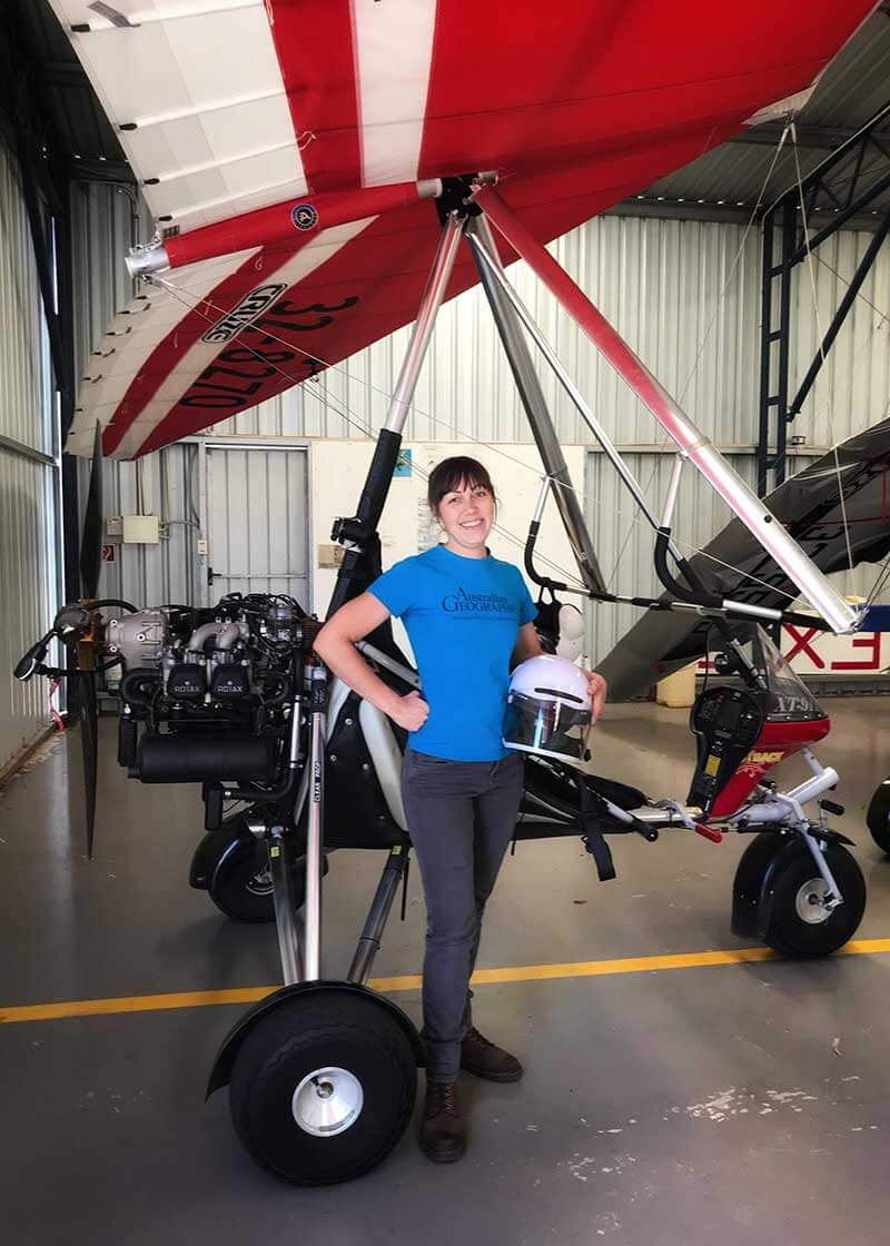 Milly Formby next to microlight