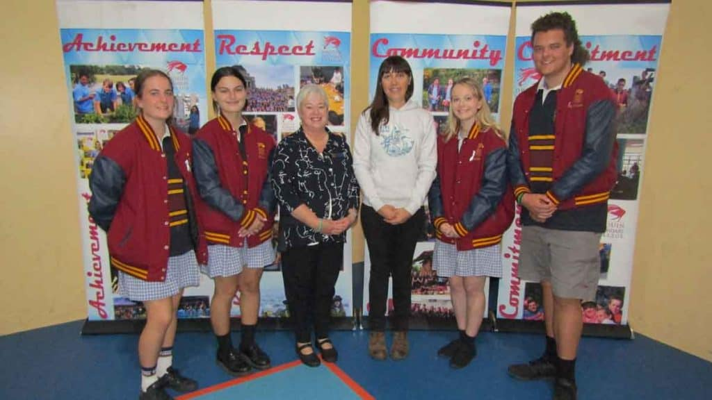 Amellia Formby with students and principal, Deb Sullivan, at Drouin Secondary College