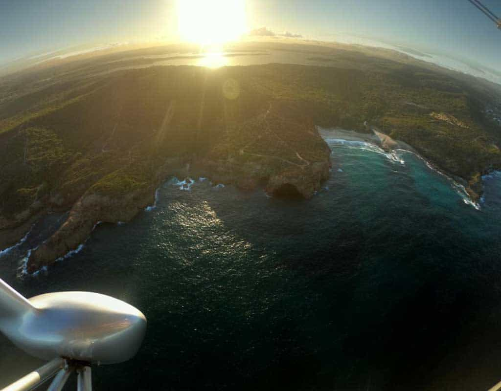 Aerial view of the coast at sunset taken from a silver microlight