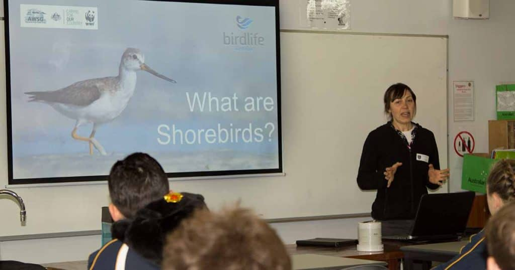 Amellia Formby presenting to students on shorebirds in a classroom