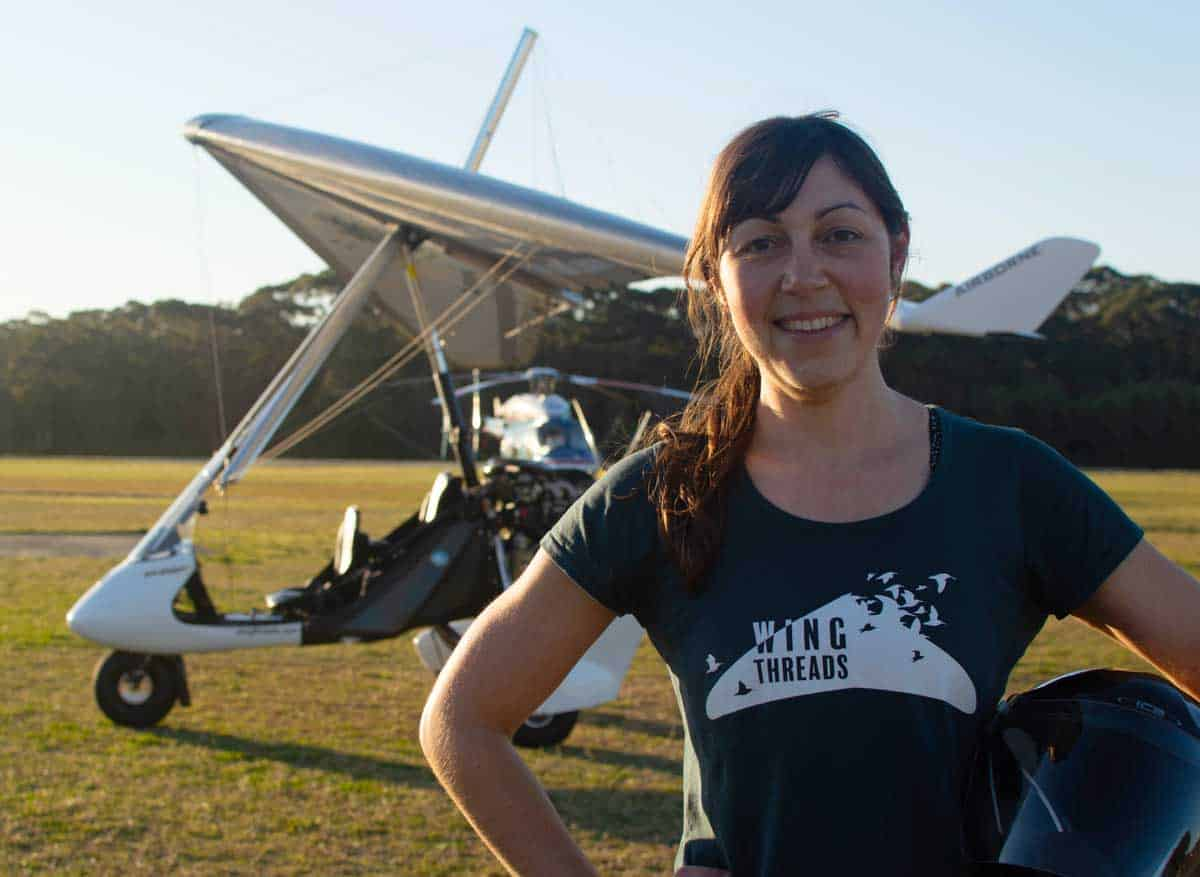 Amellia Formby with her microlight at Lake Macquarie Airport.