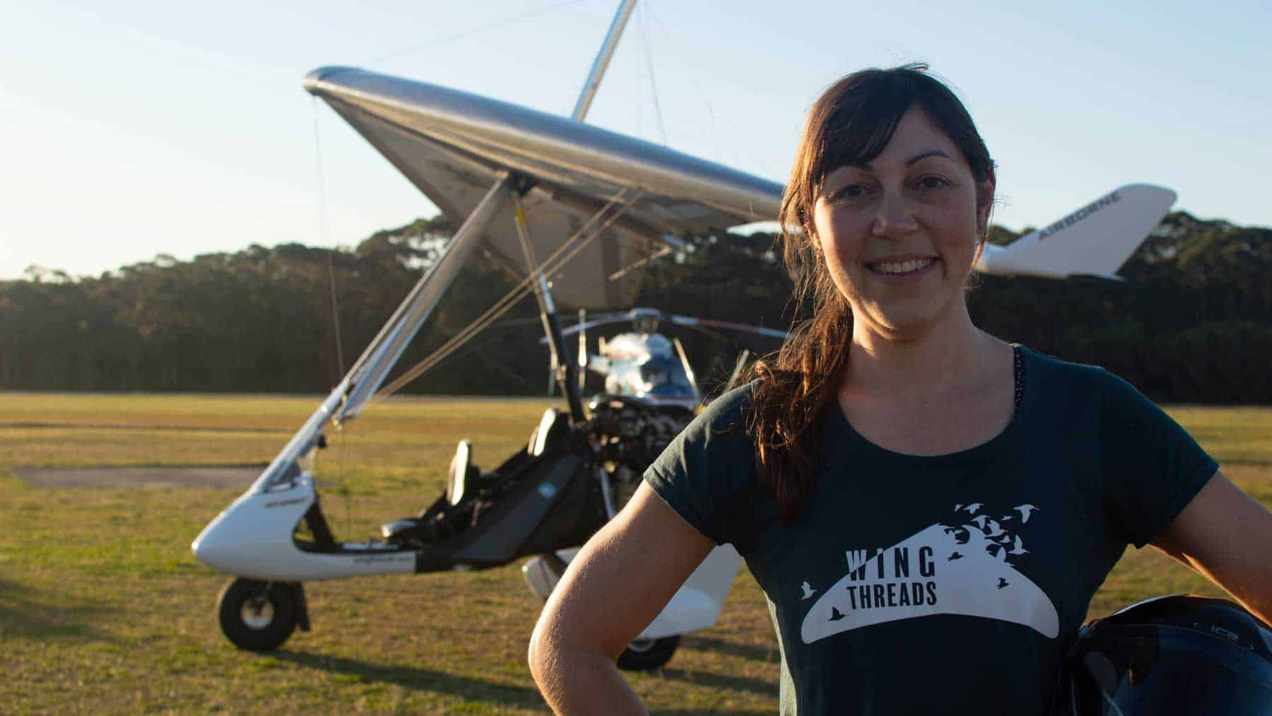 Amellia Formby standing in front of her white microlight aircraft