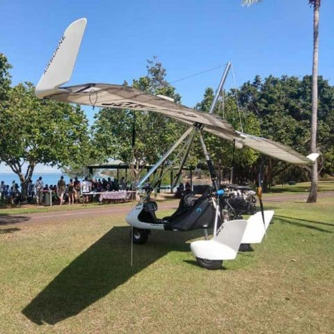 Microlight aircraft on the grass at BirdLife Top End talk in Darwin