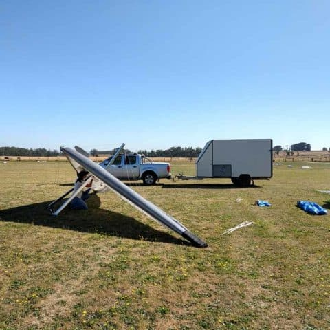 Amellia Formby setting up the wing of her microlight on the grass at Drouin Airfield