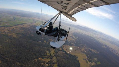 Aerial view of a microlight over the landscape