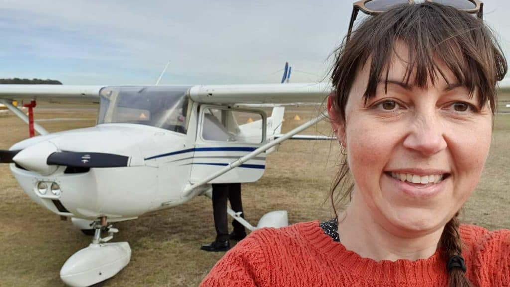 Selfie of Milly Formby with a Cessna 150